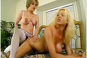 Lusty Big Boobed Shemale Getting Fucked With A Strap-on
