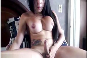 Cute big tits tranny masturbating on TScumshot