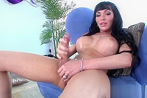 Busty tranny strokes her thick cock