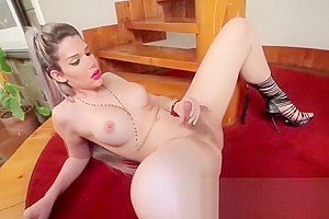 Attractive tranny Lexie Beth with big tits wanks her prick