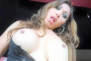 Busty Latin Shemale Stroking Her Yummy Cock