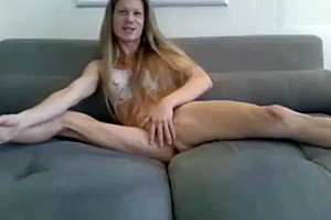 long hair blonde transgirl showing off her sexy body on the sofa