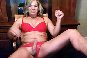 Blonde american tranny milf slowly stripping and teasing