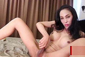 Busty Thai tranny with thick uncut cock solo