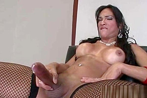 Shemale Jo Garcia shows off her big dick