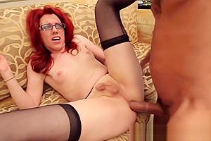 Seductive redhead shemale sucks big dick and takes it deep