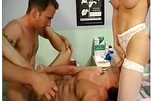 Two chaps play with a nurse tranny