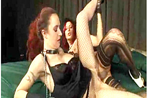 Tranny and girl play with a cock and a dildo