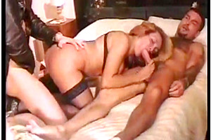 Horny mature tranny eats two cocks