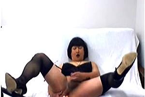 Crossdresser in black lingerie masturbating