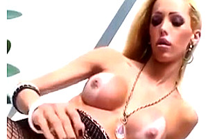 Sexy blonde TS is beating off in pantyhose
